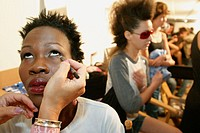 Funkshion, Fashion Week Miami event. Backstage, model having make up done. Design District. Miami. Florida. USA.