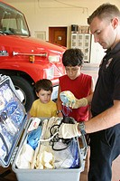 Brothers with fireman and paramedic equipment. Community Open House. Fire Station 7. Miami. Florida. USA.
