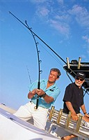 fishing buddies deep sea fishing on a boat