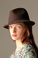 Image of young woman wearing hat