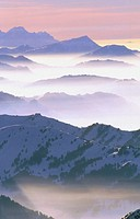 Alps of central Switzerland with fog. View from the Saentis. Appenzell. Switzerland