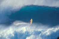 Hawaii, Maui, Jason Polakow in midst of huge crashing waves, one curls above, action