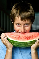 boy eating watermelon