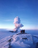 Volcanic eruption in Grimsvotn, Vatnajokull, Iceland in December 1998. Tourists watching from the Roof of a Lodge.