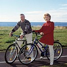 Man and a woman on bicycles, looking at camera