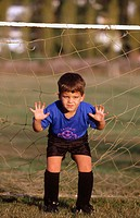 Young boy soccer goalie