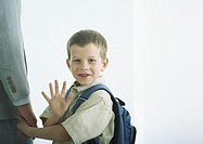 Boy holding man's hand, waving