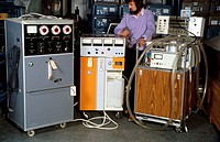 Dialysis equipment, with curator standing beside it, shown at the Science Museum's Hayes Store in Middlesex.