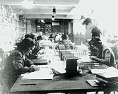 This shows one of the Hut 3 priority teams at Bletchley Park, Buckinghamshire, in which civilian and service personnel worked together at code-breakin...