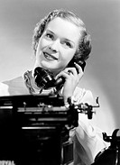 A photograph of a typist answering the telephone, taken by Photographic Advertising Limited in 1949.  Photographic Advertising Limited was founded in ...