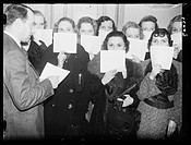 A photograph of a group of women in a beauty contest, taken by Edward Malindine for the Daily Herald newspaper on 10 January, 1936.   The women stand ...