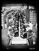 Women workers on the assembly line at the Philco radio factory in Perivale, Middlesex. Photograph taken by  Edward Malindine for the Daily Herald news...