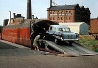 Car being loaded onto a British Railways Eastern Region train, 1962. This train transported both passengers and their cars, so that people could go on...