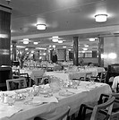 Tourist class dining room on board the 'Queen Elizabeth', at Ocean Terminal, Southampton, 1950.  This ship was launched in 1938 and was used on transa...