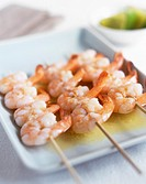 Prawns. Cooked peeled prawns on wooden skewers. Prawns are a good source of protein and iodine.