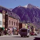 View of town's main street with mountains in the distance (thumbnail)