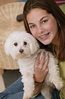 Teenager with dog, portrait