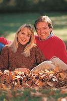 Couple in fall leaves, portrait