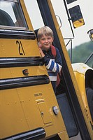Boy on school bus, portrait
