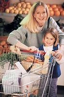 Mother and daughter grocery shopping (portrait)