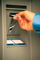 Close up of card being inserted into ATM machine