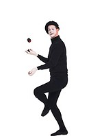 Mime juggling, portrait.