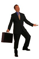 Businessman with briefcase with one leg up, portrait