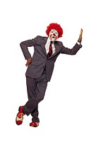Clown in business suit leaning