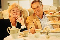 Mature couple dining, portrait