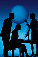 Business woman sitting and man and woman standing, talking in silhouette, back lit by a sphere