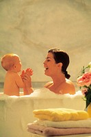 Mother and baby taking a bath, portrait