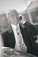Business professional talking on cell phone