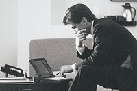 Profile of a business professional working on a laptop computer
