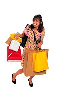 Woman overloaded with shopping bags