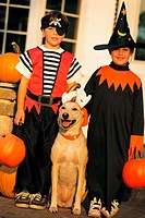 Boy and girl with dog at Halloween, portrait