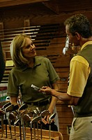 Man and woman in golf equipment store