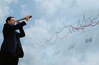Businessman looking through telescope, stock market graph