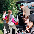 Family loading car for vacation