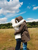 Couple in parkas hugging
