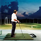 Man practising on driving range