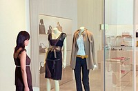 Woman looking in clothes store window (thumbnail)