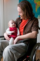 Disabled man with baby