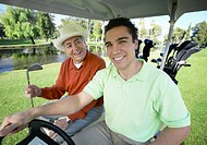 Farher With His Son Driving on a Golf Cart on a Golf Course