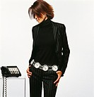 Woman Wearing a Pinstripe Suit and a Belt Made From Clocks