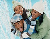 Parents With Their Son Wearing Winter Clothing
