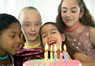 Group of Excited Young Girls Behind a Birthday Cake With Candles