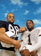 Portrait of Two Serious American Football Players Standing Side by Side