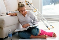 Girl with Broken Leg doing Homework