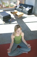 Woman Meditating in Loft Vancouver British Columbia