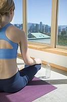Woman doing Yoga in Loft Vancouver British Columbia